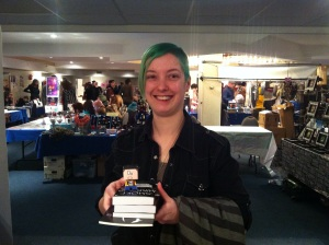 Kelly, buying the first 5 Black Womb books at Sci-Fi on the Rock 9, along with Cubecraft Steve.